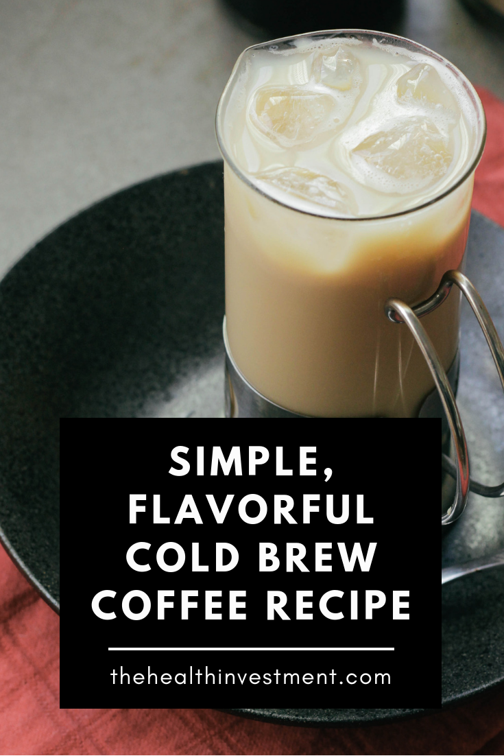 Picture of coffee with ice in a glass on top of a plate above title - Simple, Flavorful Cold Brew Coffee Recipe