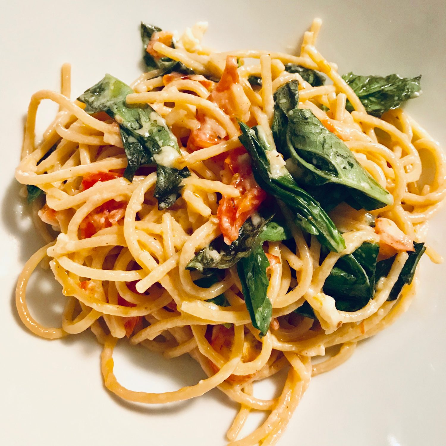 Picture of caprese pasta with brie basil and tomato