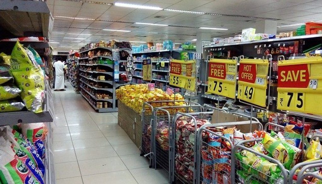 Picture of grocery store aisles with bargain signs on bins