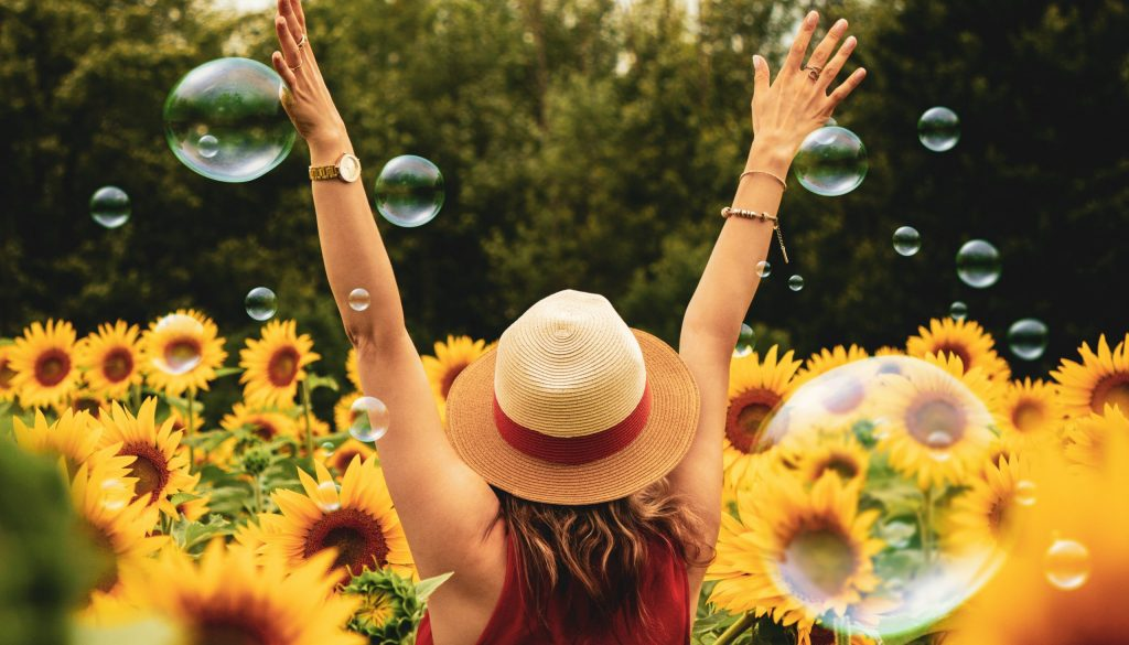 Picture of woman celebrating in the sunflowers
