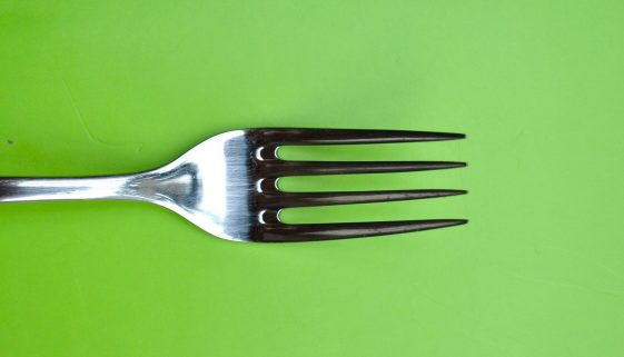 Picture of fork on green background