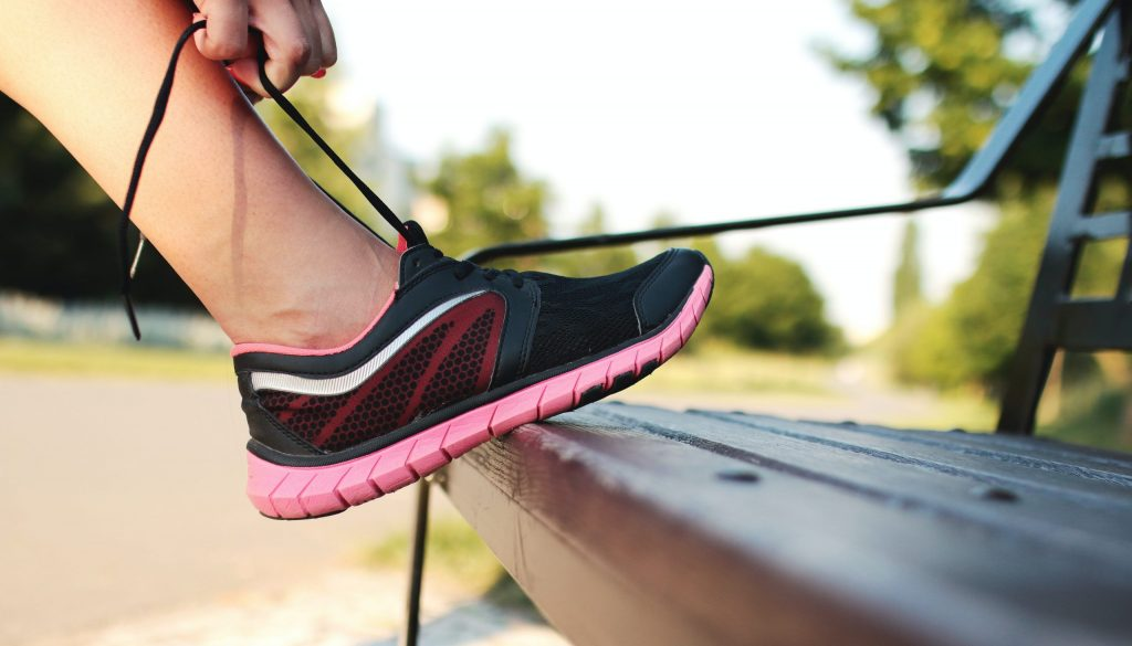 Picture of woman lacing up shoes