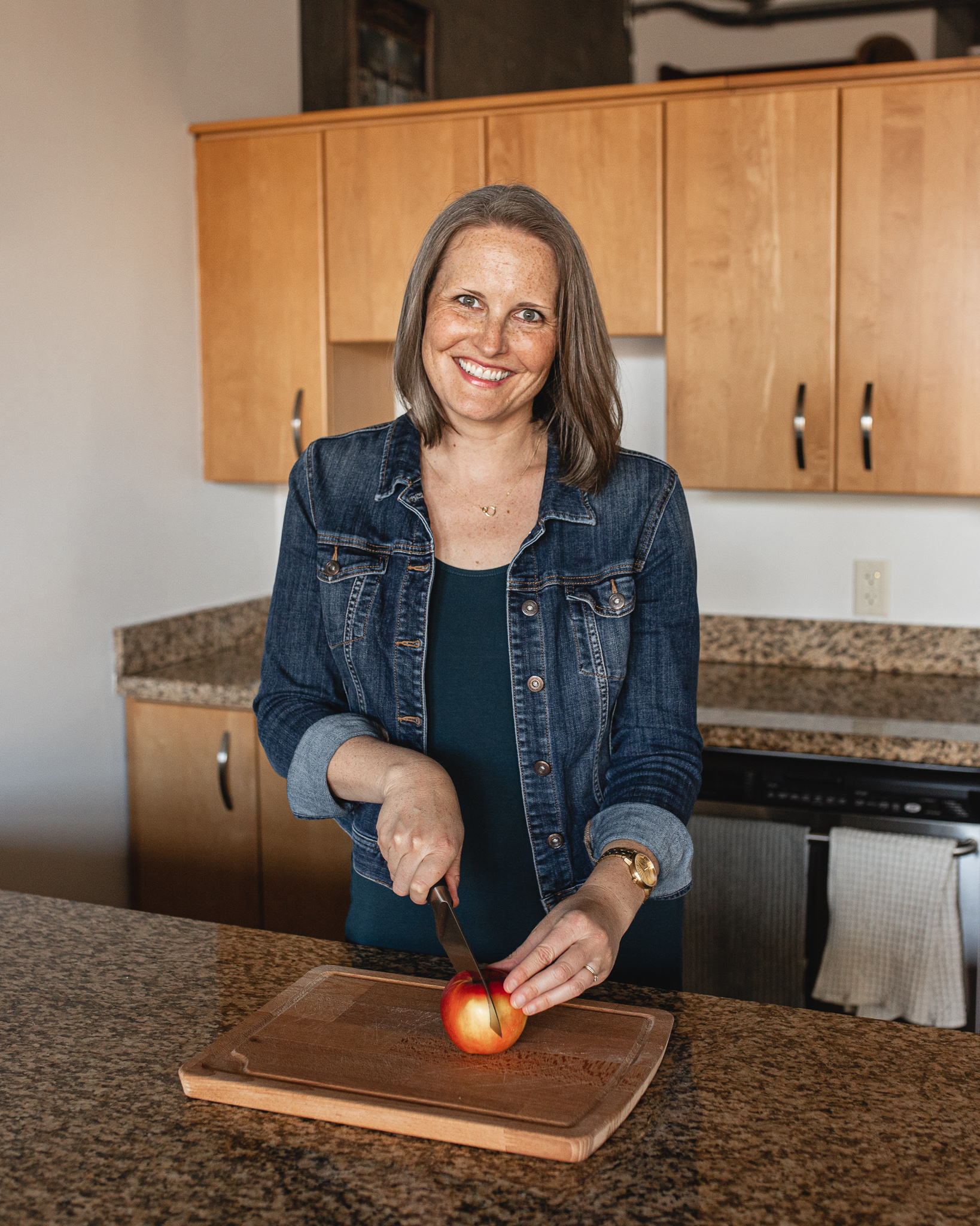 Nutritionist Brooke Simonson cutting up an apple