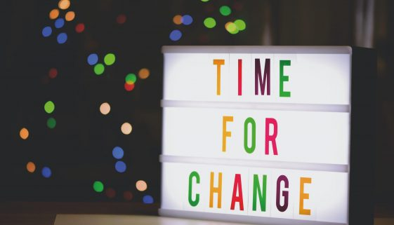 "Board showing the words ""Time For Change"