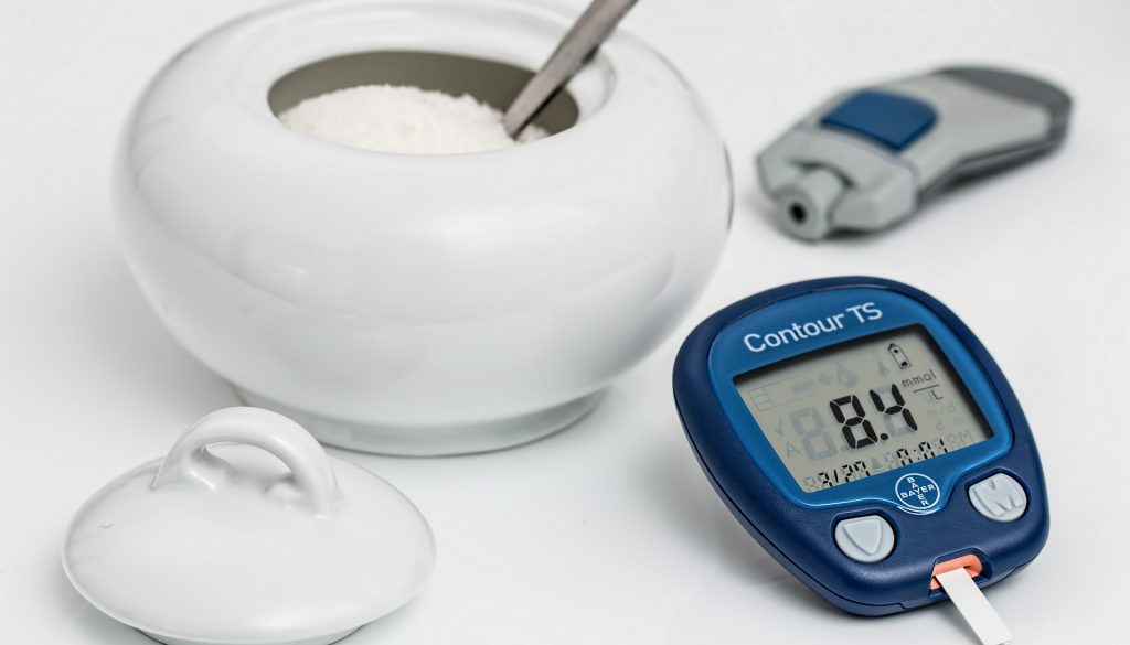 Picture of a bowl of sugar with blood glucose monitor