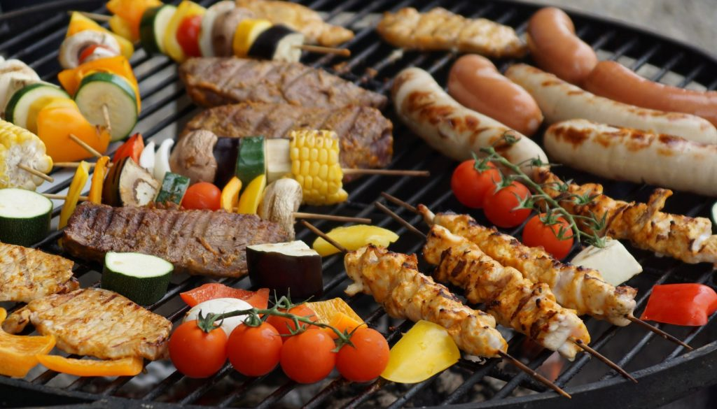 Picture of various meat kebabs on a grill