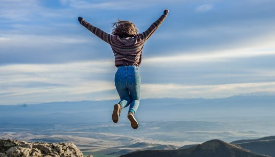 Picture of woman jumping in mountains