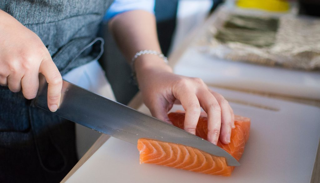 Image of person slicing fish