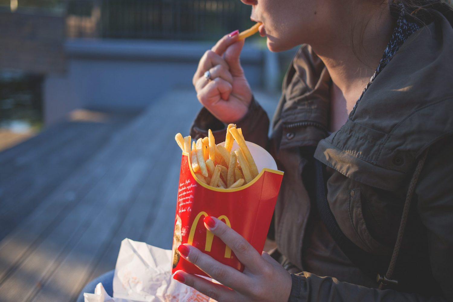 Picture of woman enjoying mcdonald's french fries