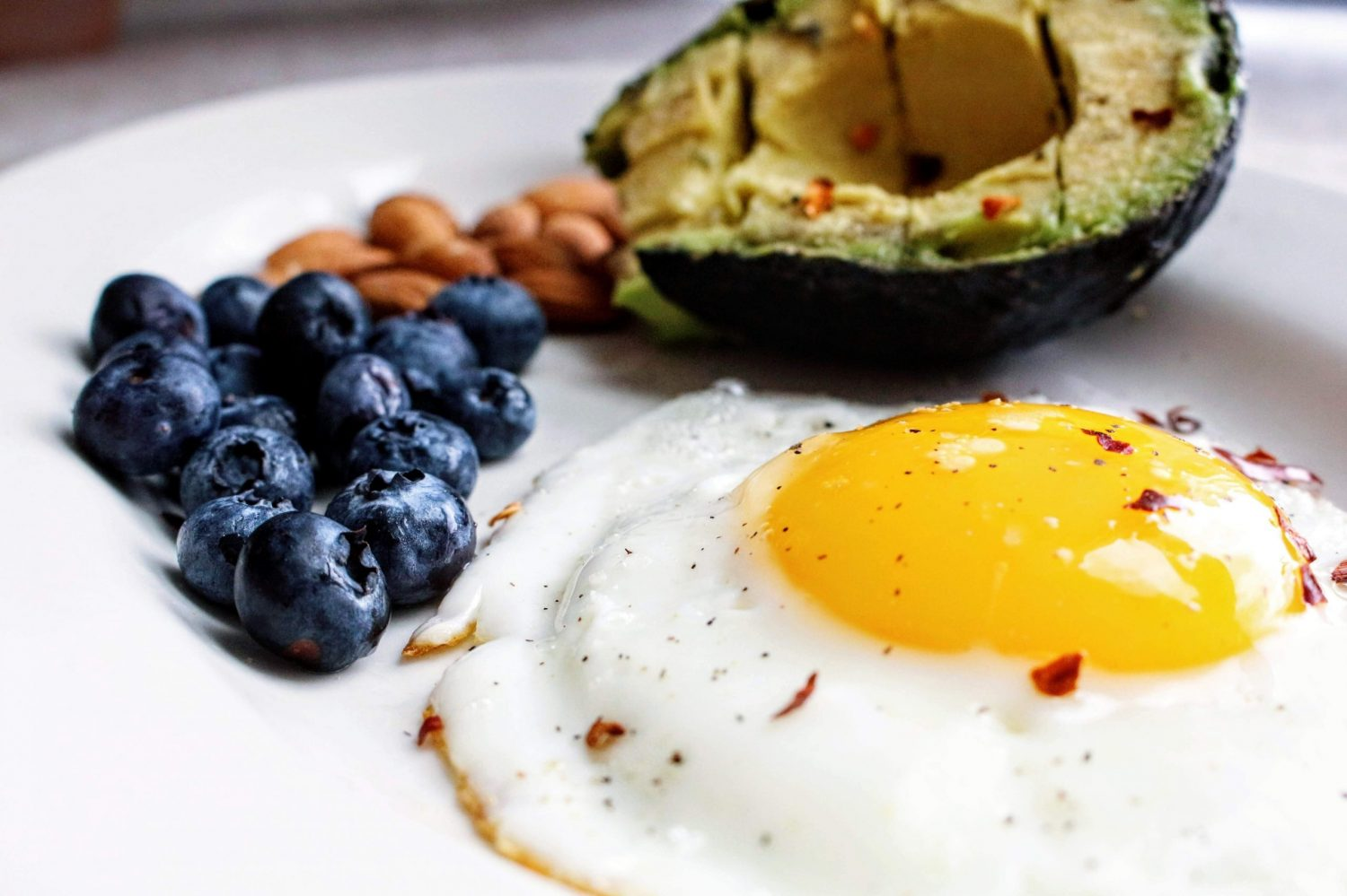 Blueberries, avocado, and fried egg