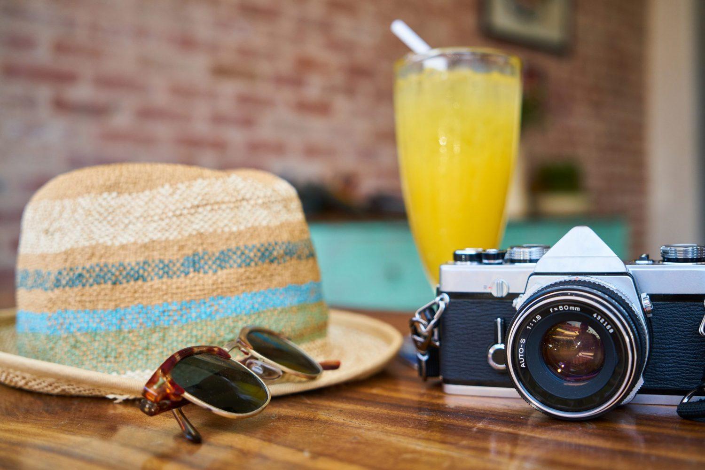 Image of hat, camera, and mimosa