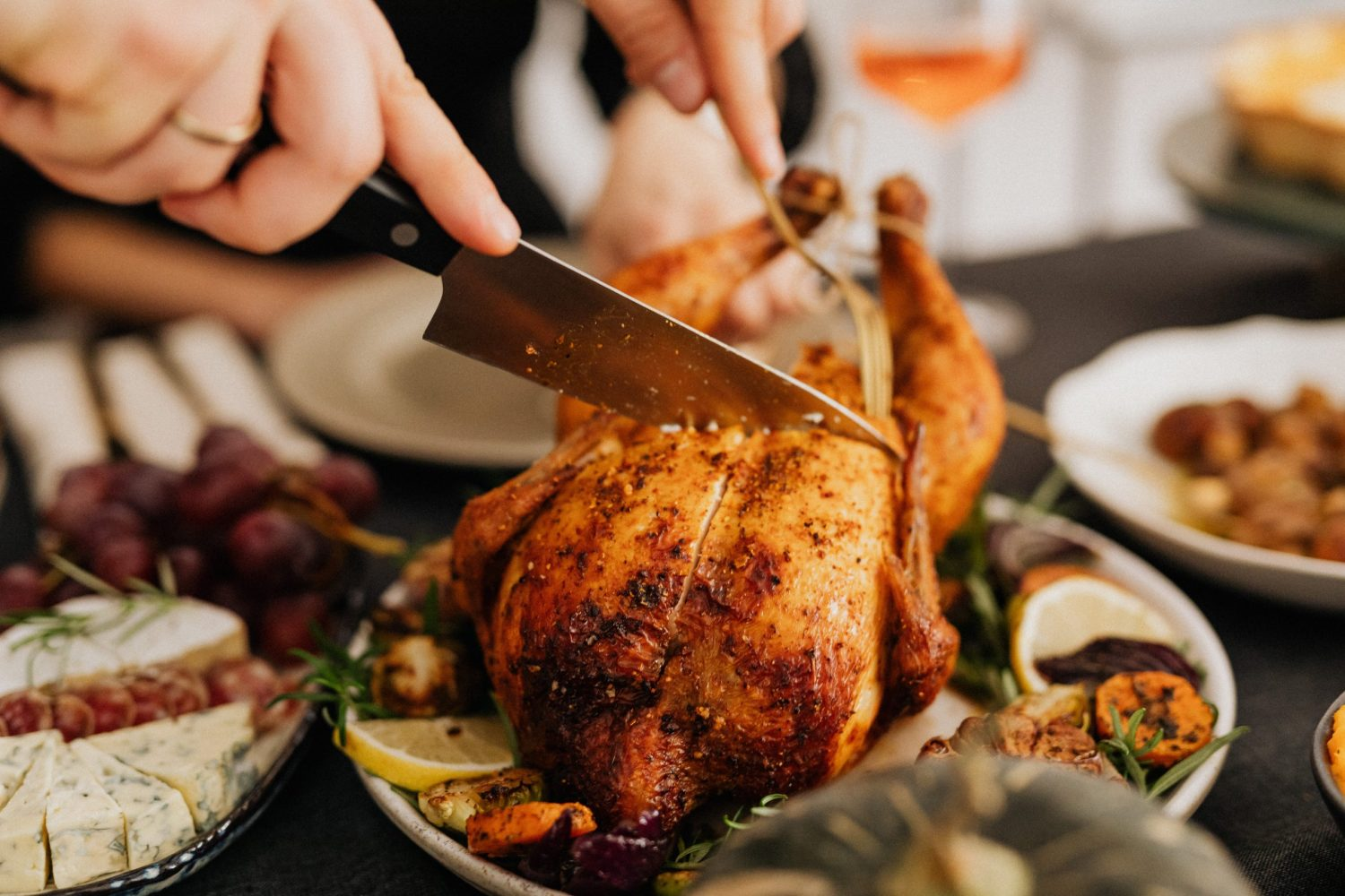 Image of person carving a chicken